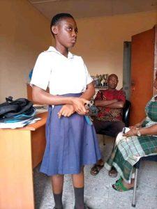 The secondary schoolgirl in the school authorities' office