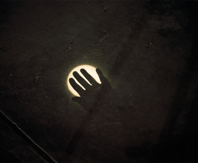 Image of sun and hand