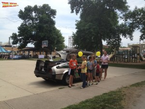 Generations of people young and old flock to the DeLorean Time Machine rental car for pictures and moments with a piece of replicated cinematic history