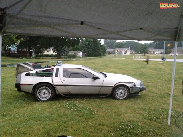 A certain movie car replica reparing for the night time viewing of Back to the Future.