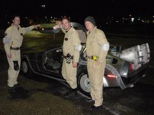 Casual Ghostbusters posing by the temporal displacement vehicle.