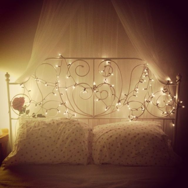 Fairy lights to decor bedroom on Christmas. fairy lights with back curtain lights decoration ideas on Christmas. Bedroom decoration ideas for beautiful back wall.