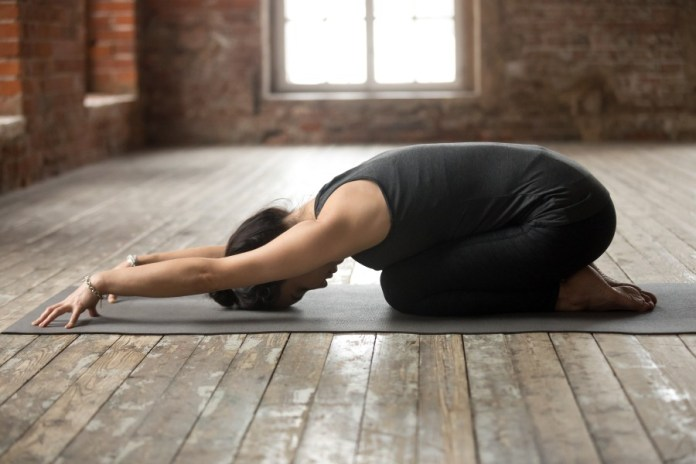 Child yoga pose for relaxation in 30-minute yoga workout sequence. Try this 30-minute morning yoga workouts to start a day great. Easy yoga poses for a beginners.