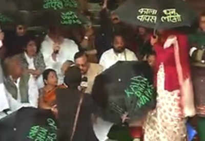 Black money: Trinamool MPs protest with black umbrellas in Parliament