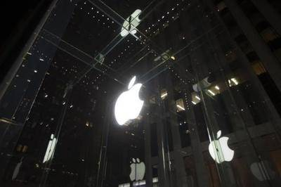 Apple has been been accused of scheming with five book publishers to raise e-book prices in an effort to slow competitors such as Amazon.com Inc.