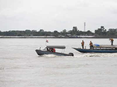 Border Security Force personnel patrol the River Brahmaputra along the India-Bangladesh border in Assam (AP Photo)