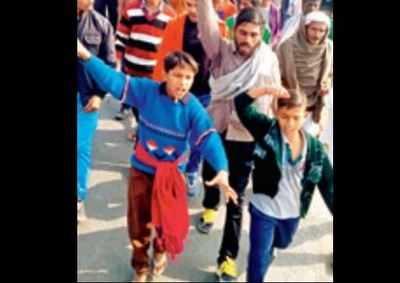 Dalits leave Mirchpur after a clash with upper caste men, on Tuesday