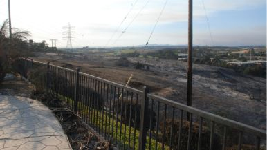 View of burned area looking east from driveway of burned-out house in Carlsbad.