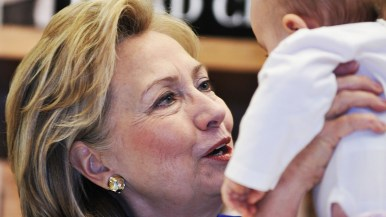 Hillary Clinton talks about becoming a grandmother as she holds an infant at Warwick's in La Jolla.