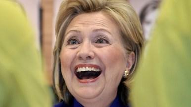 Hillary Clinton laughs at Warwick's.