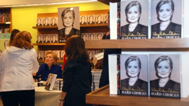 Book buyers file past Hillary Clinton for a meeting and autograph.