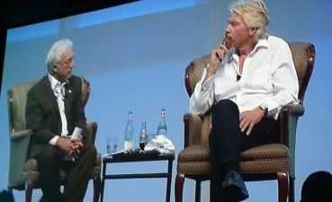Jim Greenwood, with his tie cut off by Sir Richard Branson, took part in a question-and-answer chat at the San Diego Convention Center. Photo by Ken Stone