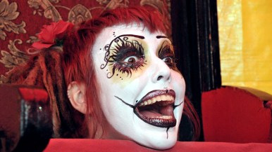Miss Spooky shows up on chair after guillotine trick in Worlds of Wonder sideshow at the San Diego County Fair.