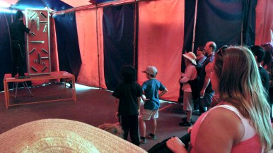 Watching act in Worlds of Wonder sideshow at the San Diego County Fair.