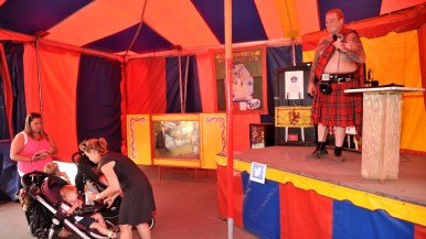 Red Stuart introduces himself and acts inside Worlds of Wonder tent at San Diego County Fair.