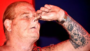 """Red Stuart displays large nail """"hammered"""" into his head via nostril in Worlds of Wonder tent at San Diego County Fair."""