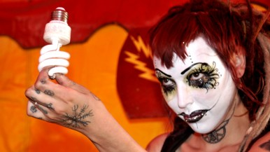 Miss Electra shows bulb she'll light in Worlds of Wonder tent at San Diego County Fair.