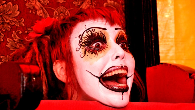 Miss Spooky reacts to having head cut off by guillotine in Worlds of Wonder tent at San Diego County Fair.