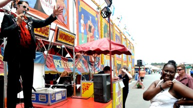 Tommy Breen pitches sideshow outside Worlds of Wonder tent at San Diego County Fair.
