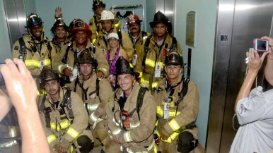 Firefighters stop to pose for a photo on the 30th floor of the Hilton.