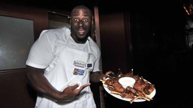 Charger Corey Liuget brings hors d'oeuvres from the Donovan kitchen.