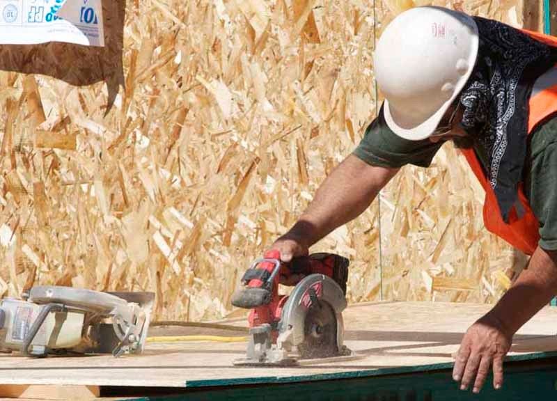 Volunteers work with Habitat for Humanity to build four homes for the needy.