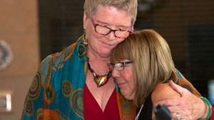 Councilwoman Marti Emerald embraces Democratic club President Linda Armacost after plaque presentation. Chris Stone photo