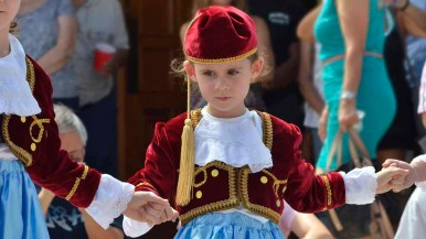 A young girl dances a traditional Greek dance at the Saints Constantine and Helen Greek Orthodox Church at Cardiff. Photo by Chris Stone
