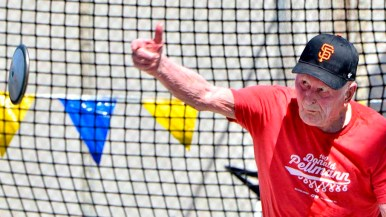 Don Pellmann sets a world record for the M100 age group in the discus. Photo by Chris Stone
