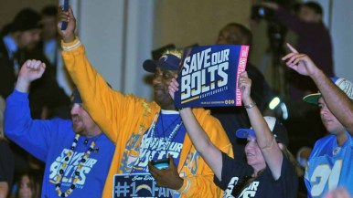 Save the Bolts followers cheer for the Chargers at the NFL forum. Photo by Chris Stone
