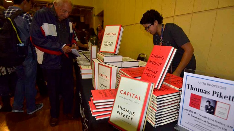 """""""Capital"""" sold for $40 in lobby of Mandeville Auditorium. His thinner book, """"The Economics of Inequality,"""" went for $20."""