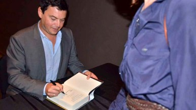Thomas Piketty signed books from young and old after his talk at Mandeville Auditorium. Photo by Ken Stone