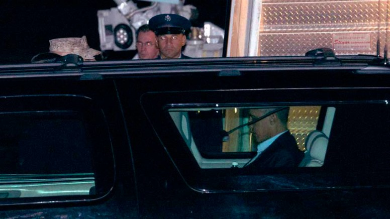 """President Obama sits in his limousine, the """"Beast,"""" while waiting to be taken to Rancho Santa Fe. Photo by Chris Stone"""