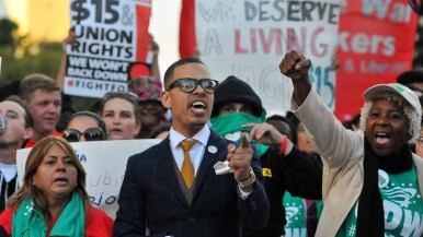 Rev. Shane Harris, pastor of the City of Grace Church and president of the SD chapter of National Action Network, center, leads chants. Photo by Chris Stone