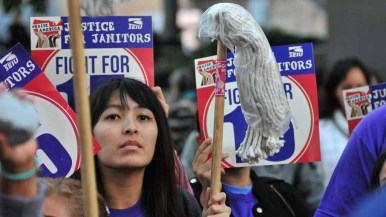 """Workers with """"Justice for Janitors"""" signs attended the afternoon rally at San Diego City Hall. Photo by Chris Stone"""