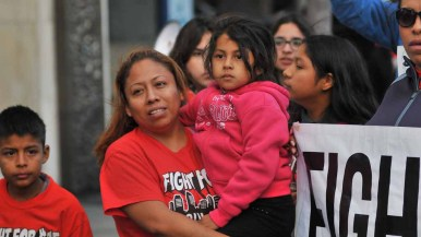 About 400 demonstrators marched in downtown streets for a raise in the minimum wage. Photo by Chris Stone