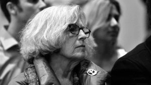 An audience member listens to Bob Woodward and Alexander Butterfield at UCSD. Photo by Chris Stone
