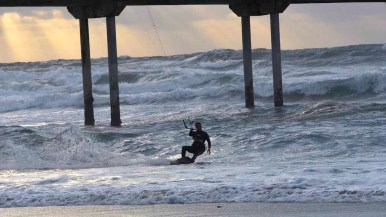 High winds fueled an impromptu kite-surfing performance for beach-goers Friday at Ocean Beach. Photo by Chris Stone.