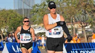 John Nunn begins shedding arm warmer early in race at men's Olympic Trials 50K race walk. Photo by Ken Stone