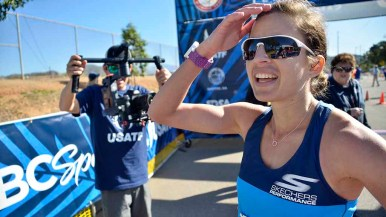 Robyn Stevens is captured by cameraman after winning the 20K. Photo by Ken Stone