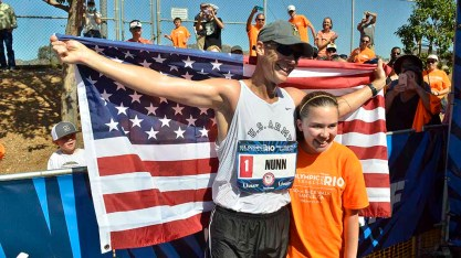 John Nunn and daighter Ella pose for photographers at finish of Olympic Trials 50K walk. Photo by Ken Stone