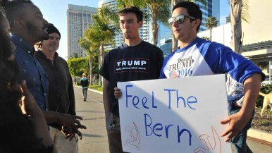 Donald Trump supporters showed their sign to Bernie Sanders backers. Photo by Chris Stone