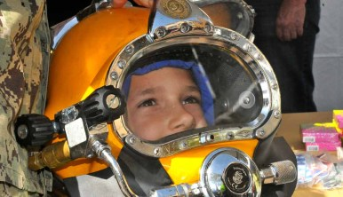 The Navy allowed visitors to check out their dive helmets. Photo by Chris Stone