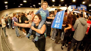 Young children rode shoulders throughout the San Diego Convention Center. Photo by Ken Stone