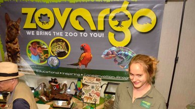 Maddie Mullins staffed table of Zovargo, a traveling zoo less than a year old. Photo by Ken Stone