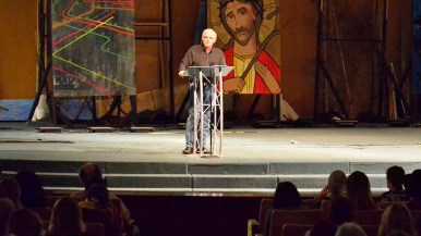 Richard Louv spoke on a stage at the Brown Chapel theater at Point Loma Nazarene University. Photo by Ken Stone