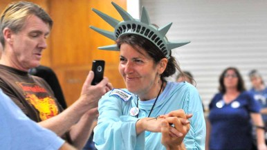Josephine Piarulli Frodente reacts upon hearing she was top female vote-getter. John Mattes takes photos behind her. Photo by Chris Stone