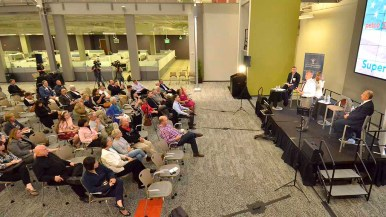 Supervisor Dave Roberts addresses audience in vast Petco room called the community park. Photo by Ken Stone