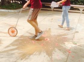 Student wheels through splattered watermelon. Photo Credit: Cassia Pollock