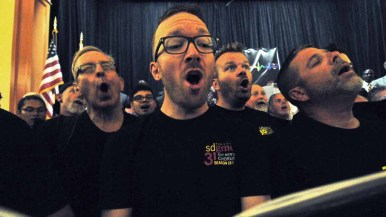 """Members of the San Diego Gay Men's Chorus sing """"Somewhere Over the Rainbow."""" Photo by Chris Stone"""